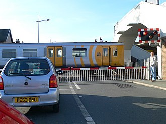 Level crossing - A level crossing at Hoylake, Merseyside, England, UK with a train passing