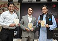 "The Minister of State for Human Resource Development, Dr. Shashi Tharoor releasing a book titled ""BOOMTOWN"", written by Aditya Mukherjee, at a function, in New Delhi on July 15, 2013.jpg"