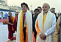 The Prime Minister, Shri Narendra Modi and the Prime Minister of Japan, Mr. Shinzo Abe being given traditional welcome, on their arrival at Varanasi, Uttar Pradesh on December 12, 2015 (2).jpg