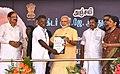 The Prime Minister, Shri Narendra Modi distributing the Sanction Letters to beneficiaries of Long Liner Trawlers under 'Blue Revolution Scheme', at Rameswaram, Tamil Nadu.jpg