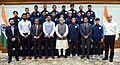 The Prime Minister, Shri Narendra Modi in a group photograph with the Indian Team that participated in FIFA U-17 World Cup, in New Delhi.jpg