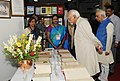 The Vice President, Shri M. Hamid Ansari looking at the collection of ancient books, at the Asiatic Society, in Kolkata on October 03, 2016. The Governor of West Bengal, Shri Keshari Nath Tripathi is also seen.jpg