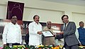 The Vice President, Shri M. Venkaiah Naidu presenting the International Gandhi Award 2017 to Dr. Atul Shah for his humanitarian services to alleviate the suffering of leprosy-affected persons, in Sewagram, Wardha, Maharashtra.jpg