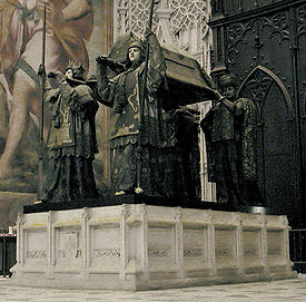 Columbus' tomb in the cathedral of Seville. It is borne by four statues of kings representing the Kingdoms of Castile, Leon, Aragon, and Navarre.