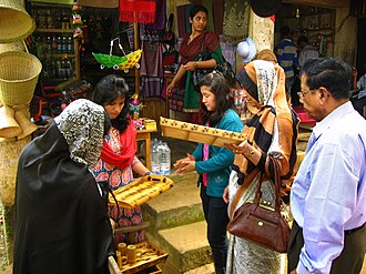 Bangladeshis - A Bawm woman (centre) selling handicrafts to domestic tourists in Bandarban