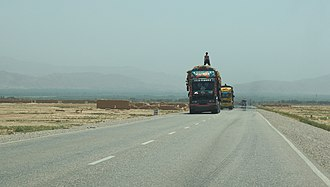 Transport in Afghanistan - Trucks on a highway in northern Afghanistan