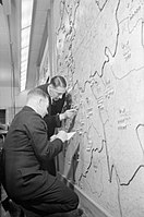 Two members of the Auxiliary Fire Service update an incident map nn the wall of the London Fire Brigade Headquarters, 1940. D2622.jpg