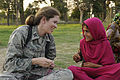 U.S. Air Force Capt. Mary Danner-Jones, a public affairs officer with the Nangarhar Provincial Reconstruction Team, helps an Afghan girl make a friendship bracelet during a Girl Scout meeting at Forward 100821-F-FW394-149.jpg