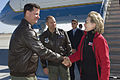 U.S. Air Force Col. Gary Gottschall, left, and Col. James Vechery, center, greet Secretary of State Hillary Rodham Clinton during a refueling stop at Travis Air Force Base, Calif 101027-F-HM396-008.jpg