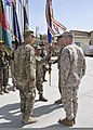 U.S. Army Command Sgt. Maj. Gabriel Cervantes, center left, with NATO Training Mission-Afghanistan (NTM-A) and Combined Security Transition Command-Afghanistan (CSTC-A), hands the CSTC-A command flag to outgoing 130402-N-HU588-019.jpg