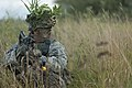 U.S. Army Sgt. Michael Montgomery, a Cavalry scout with Bravo Troop, 1st Squadron, 172nd Cavalry Regiment, 86th Infantry Brigade Combat Team, Vermont Army National Guard, surveys his surroundings during an air 130813-Z-KE462-090.jpg