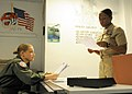 U.S. Naval Aircrewman (Mechanical) 3rd Class Chelsi Tow, left, assigned to Patrol Squadron (VP) 47, speaks with Chief Aviation Maintenance Administrationman Tiffanie Simpson about Tow's exam worksheet for 130812-N-PP197-003.jpg