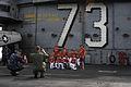 U.S. Sailors aboard the aircraft carrier USS George Washington (CVN 73) take photos of a local youth baseball team during a ship tour Nov. 9, 2013, in Hong Kong 131109-N-QQ884-063.jpg