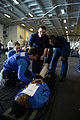 U.S. Sailors inspect a simulated victim during a mass causality training exercise in the hangar bay of the aircraft carrier USS George H.W. Bush (CVN 77) in the Atlantic Ocean May 21, 2013 130521-N-YZ751-091.jpg