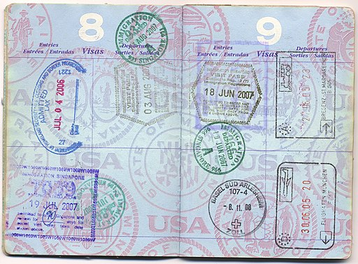 USA passport with immigration stamps from Austria, Germany, Singapore and the US - 20120708