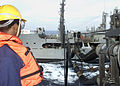 US Navy 020821-N-6920A-002 Sailor mans his station during an unrep.jpg