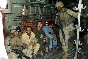 3rd Light Armored Reconnaissance Battalion - Marines talk with rescued American POWs on a C-130 Hercules.
