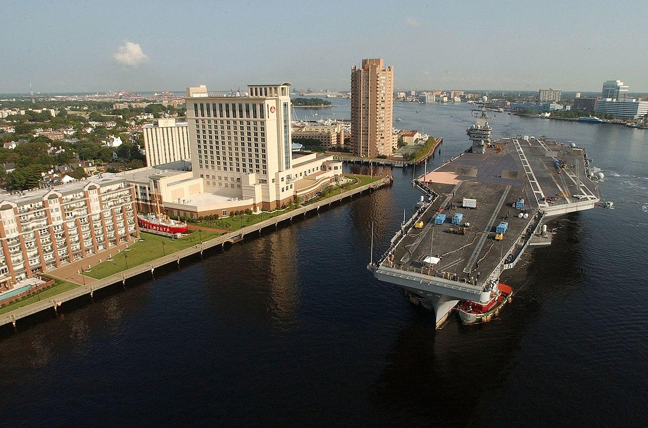 File:US Navy 030820-N-9851B-053 Tug boats guide USS Harry S