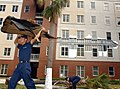 US Navy 040921-N-1539M-003 Students assigned to the Naval Air Technical Training Center (NATTC) on board Naval Air Station Pensacola, Fla., work to clear their barracks of debris left by Hurricane Ivan.jpg