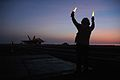 US Navy 050705-N-0000X-010 An aircraft director signals for an F-A-18 Hornet to taxi forward during night flight operations aboard the Nimitz-class aircraft carrier USS Carl Vinson (CVN 70).jpg