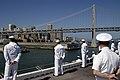 US Navy 051008-N-3289C-001 Sailors aboard the amphibious assault ship USS Boxer (LHD 4) man the rails as they pass under the San Francisco-Oakland Bay Bridge.jpg