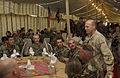 US Navy 051127-F-0692M-013 U.S. Navy Rear Adm. Mike Lefever, right, talks with Navy Seabees before they eat their Thanksgiving Dinner at the 212th Mobile Army Surgical Hospital in Muzaffarabad, Pakistan.jpg
