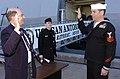 US Navy 060113-N-2568S-100 Secretary of the Navy, Dr. Donald C. Winter administers the oath of reenlistment to Quartermaster 1st Class Thomas E. Dowling on the pier.jpg