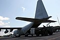 US Navy 060608-M-1837P-001 Two U.S. Marine Corps C-130 Hercules airplanes assigned to 1st Marine Aircraft Wing in Okinawa, Japan, arrived at the Yogyakarta airport with 11 tons of medical supplies donated by private American ph.jpg