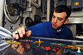 US Navy 070520-N-9928E-003 Aviation Boatswain's Mate Airman Jason Skonieczny plots aircraft movements on the Ouija board in hangar deck control,.jpg