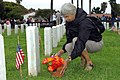 US Navy 070528-N-4658L-014 Valerie Gilbert lays flowers out for her husband who served in the Navy during World War II at the Veterans Memorial Day Committee 107th Memorial Service and Day of Remembrance Ceremony at Fort Rosecr.jpg