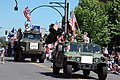 US Navy 070704-N-5324R-001 Seabees attached to Navy Mobile Construction Battalion (NMCB) 18 ride by Humvee and Medium Tactical Vehicle Replacement in Everett's 4th of July parade.jpg