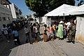 US Navy 070902-N-8704K-164 Patients line up outside Hopital De L'universite D'etat D'Haiti, where Military Sealift Command hospital ship USNS Comfort (T-AH 20) personnel are providing medical care.jpg