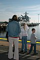 US Navy 071016-N-1082Z-005 Family members of Lt. Cmdr. Thomas Kait, executive officer of dock landing ship USS Fort McHenry (LSD 43), watch as the ship departs from Naval Amphibious Base Little Creek.jpg