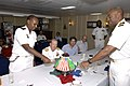 US Navy 071215-F-0509T-106 Djiboutian Navy Lt. Waiss Omar Bogoreh and U.S. Navy Commodore Frank Ponds cut a Djiboutian and American flag cake to symbolize a partnership between the two countries during a reception at end the Op.jpg