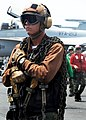 US Navy 080727-N-9116H-002 A plane captain stands by to secure an aircraft.jpg