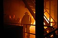 US Navy 080813-N-6936D-080 Members of the No. 1 hose team from Repair Locker 2M of the amphibious assault ship USS Essex (LHD 2) fight a fire at the Center for Naval Engineering Learning Site, Yokosuka.jpg