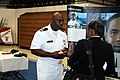 US Navy 080924-N-2539L-035 Lt. Derrick Mitchell talks about the many Navy opportunities with a South Carolina State University student.jpg