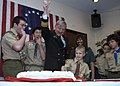 US Navy 090228-N-2013O-060 Rear Adm. James D. Kelly cuts the celebratory cake with the help of local scouts after receiving the Distinguished Eagle Scout Award.jpg