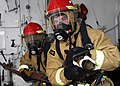 US Navy 090411-N-5215E-014 Damage Controlman Fireman Apprentice Jeff Kingree and Damage Controlman 3rd Class Kevin Martinez prepare to combat a simulated fire during a damage control drill.jpg