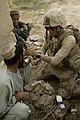 US Navy 091031-M-5160M-303 Hospitalman 3rd Class Paul Zapanta treats a local Afghan man for a cut to his head during a patrol.jpg