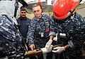 US Navy 091110-N-3620B-002 Chief Hull Technician John M. Kaczor gives instruction on proper pipe patching procedures during a general quarters drill aboard the aircraft carrier USS Enterprise (CVN 65).jpg