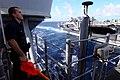 US Navy 100218-N-4275C-005 Quartermaster Seaman Matthew Rivera signals during a visual communications exercise aboard SS Bunker Hill (CG 52).jpg