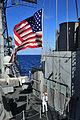 US Navy 100412-N-4774B-026 Quartermaster 1st Class Michael Sloan raises the Battle Ensign aboard USS Bunker Hill (CG 52).jpg