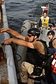 US Navy 100420-F-4109M-005 Engineman 2nd Class Griffith Riensche, from Kirkland, Wash., assigned to the amphibious dock landing ship USS Gunston Hall (LSD 44), boards the Senegalese navy ship Poponnquine during a visit, board,.jpg