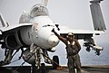 US Navy 100704-N-6003P-077 A plane captain assigned to the Checkerboards of Marine Fighter Attack Squadron (VMFA) 312 gives a thumbs-up to signal that the F-A-18C Hornet is ready to be moved.jpg