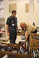 US Navy 100806-N-6936D-020 Sailors sort shoes that will be given to children in need through the Klothes for Kids program.jpg