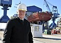 US Navy 110223-N-ZB612-014 Chief of Naval Operations (CNO) Adm. Gary Roughead poses for a photograph with the keel of the future guided-missile des.jpg