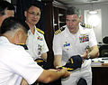 US Navy 110813-N-DB801-369 Capt. Daniel Grieco presents a command ball cap to Republic of Korean navy Capt. Lee.jpg