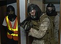 US Navy 110819-N-UU879-058 Marines enter a simulated ship's cabin during a VBSS exercise.jpg