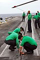 US Navy 110826-N-KF029-037 Aviation boatswain's mates clean a catapult on the flight deck aboard the aircraft carrier USS Ronald Reagan (CVN 76).jpg